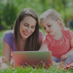 mother-with-daughter-laptop-outdoor