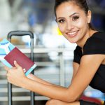 20668045 – cheerful businesswoman waiting for her flight at airport