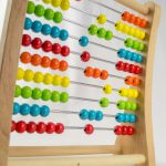 56920905 – colorful abacus with the money sign over a white background